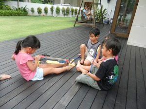 Emmy showing the boys her crossbow
