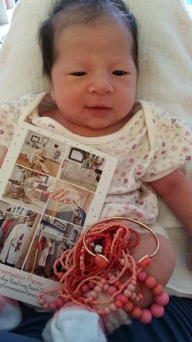 "Hello from a 2-week old Alyssa!  ""It's all mine, Mummy!"""