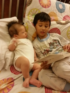 Asher being the big Kor Kor and reading to his little sister