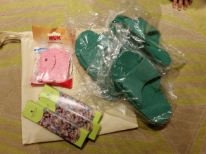 Slippers, toothbrushes in kids size, and even a sponge because they know we have a baby with us!
