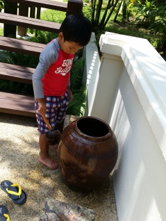 Ellery loved scooping the water out of the big pots to wash his sandy feet