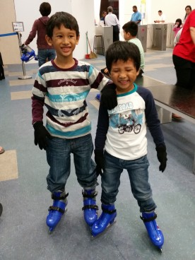 They were so pleased with themselves that they could walk with the ice skates on