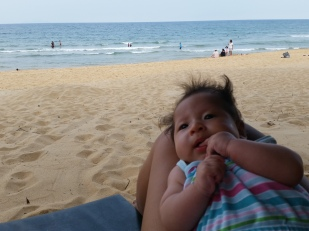 Alyssa enjoying her first beach holiday