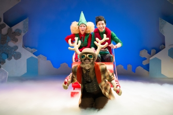 Chipper the elf (Seong Hui Xuan) and Junior (Dwayne Tan) flying off to Singapore with Dasher (Benjamin Chow)