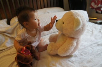 Playing with her favourite two bears. She especially loves that dark brown bear we got in Hong Kong
