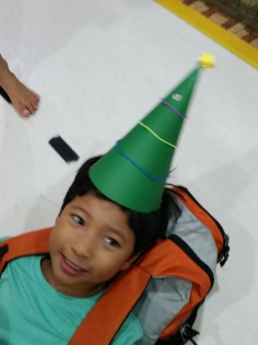Leaving school yesterday with the Christmas hat he made