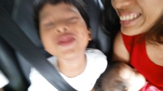 Being cheeky in the car and not wanting to stay still for a picture :)