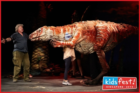 Hugging a 'T-Rex' (Photo courtesy of ABA Productions)