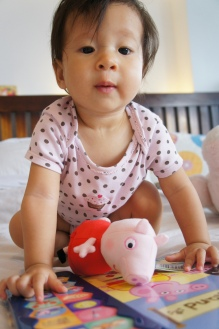 With her new Peppa Pig toy that my Mum bought for her