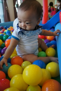 Little Dean enjoying the ball pit
