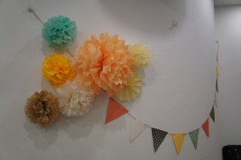 Pom poms and bunting - I liked these so much they are now hanging in Alyssa's bedroom :)