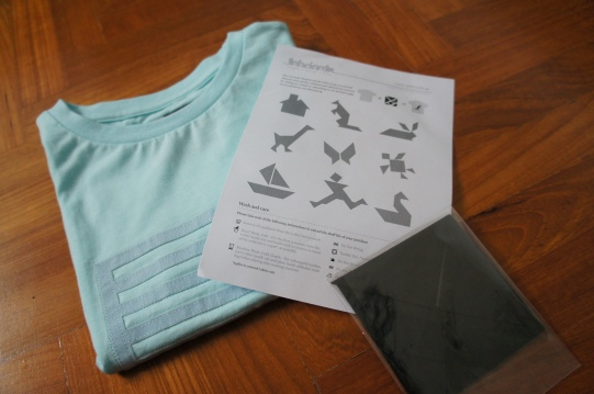 Each Tangram Tee comes with a set of tangram shapes and a starter guide for a few designs to try out
