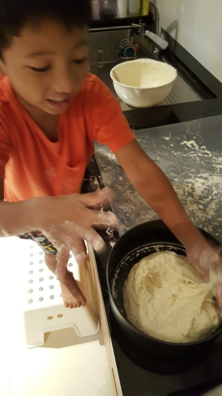 Pressing down the dough in the pan.