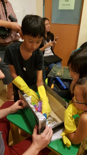 Exploring sensory bins with and without gloves to discover the differences in the experience (Photo credit: The Little Executive)
